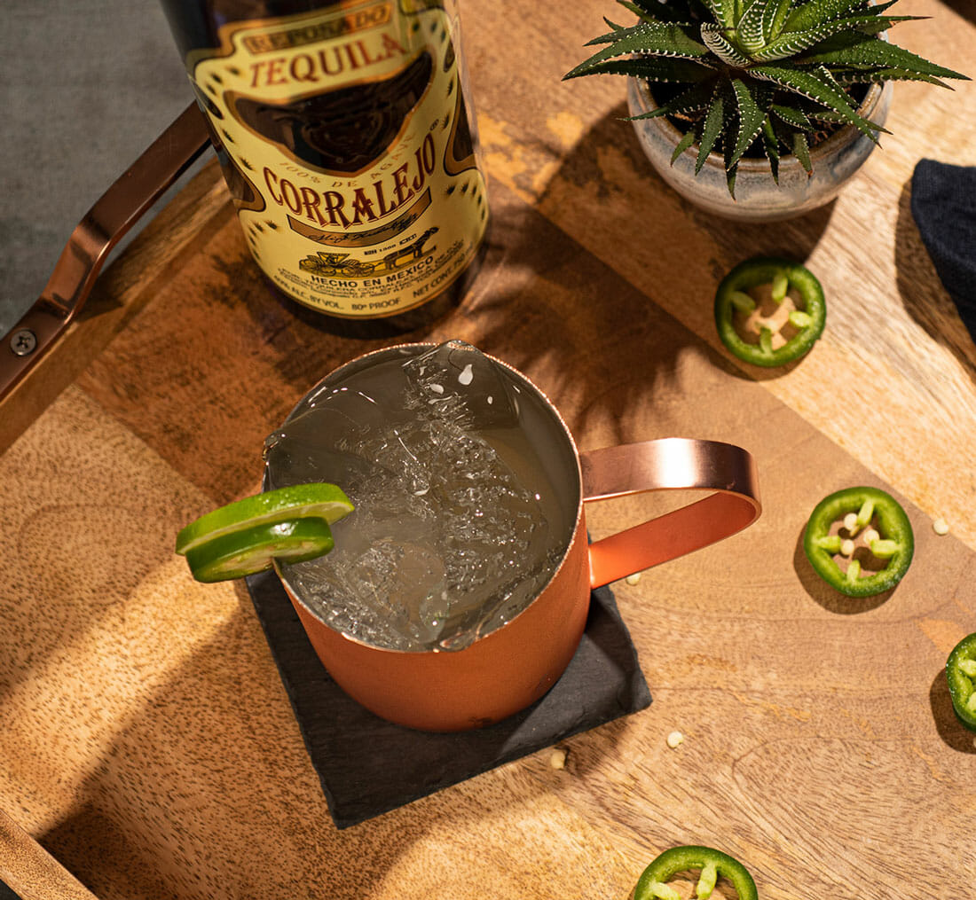 top down version of the mexican mule cocktail with the Corralejo Reposado bottle